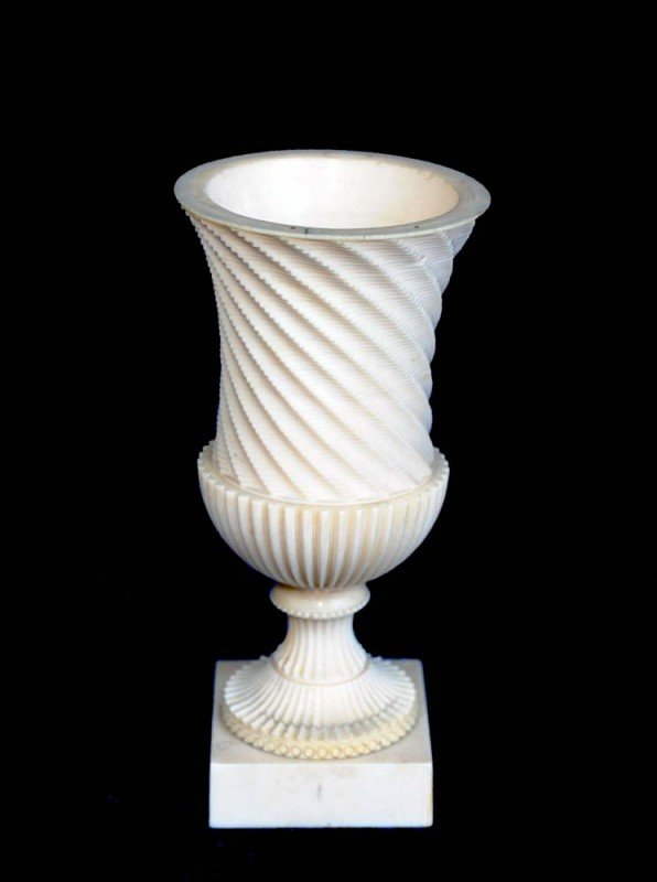 11: CONTINENTAL CARVED IVORY FIGURE OF AN URN