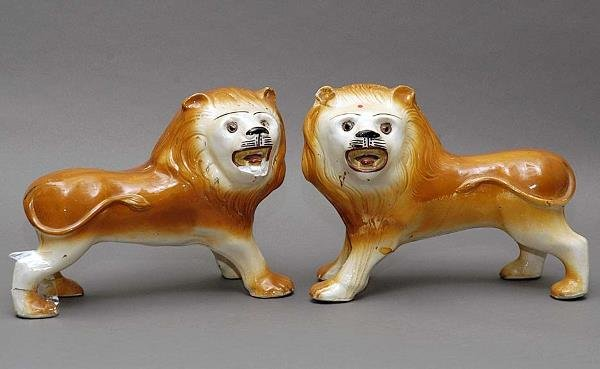 7: Pair of Antique English Staffordshire Lions