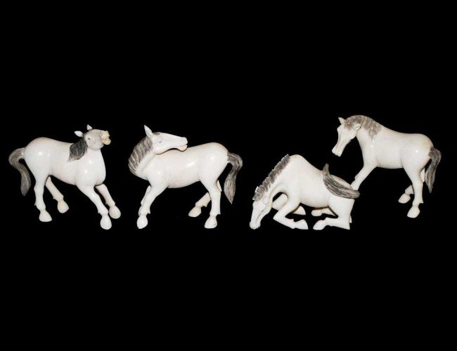 8: GROUP OF FOUR CARVED IVORY HORSES