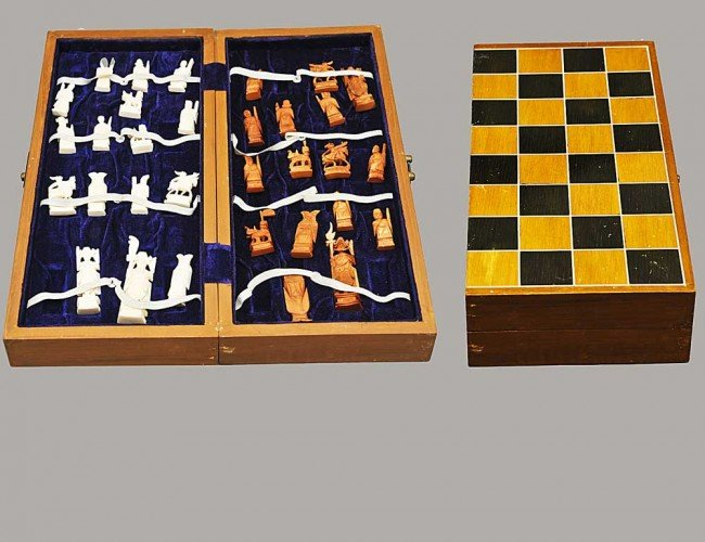 311: CARVED IVORY FIGURAL CHESS SET