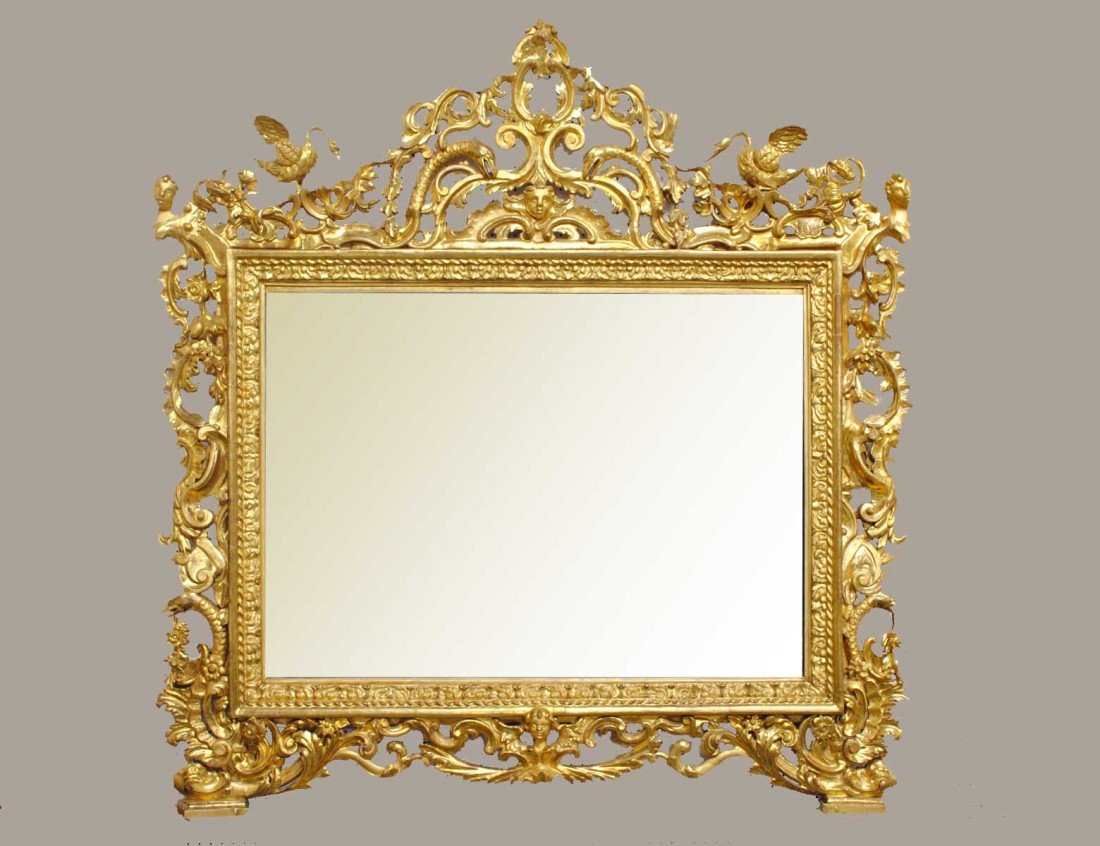 228: SPECTACULAR CARVED AND GILTWOOD MIRROR