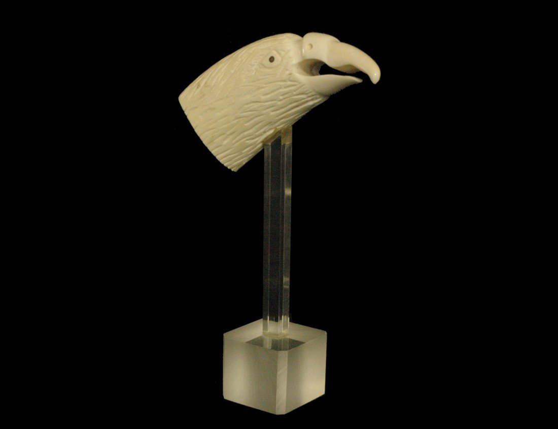 20: CARVED BONE HEAD OF AN EAGLE