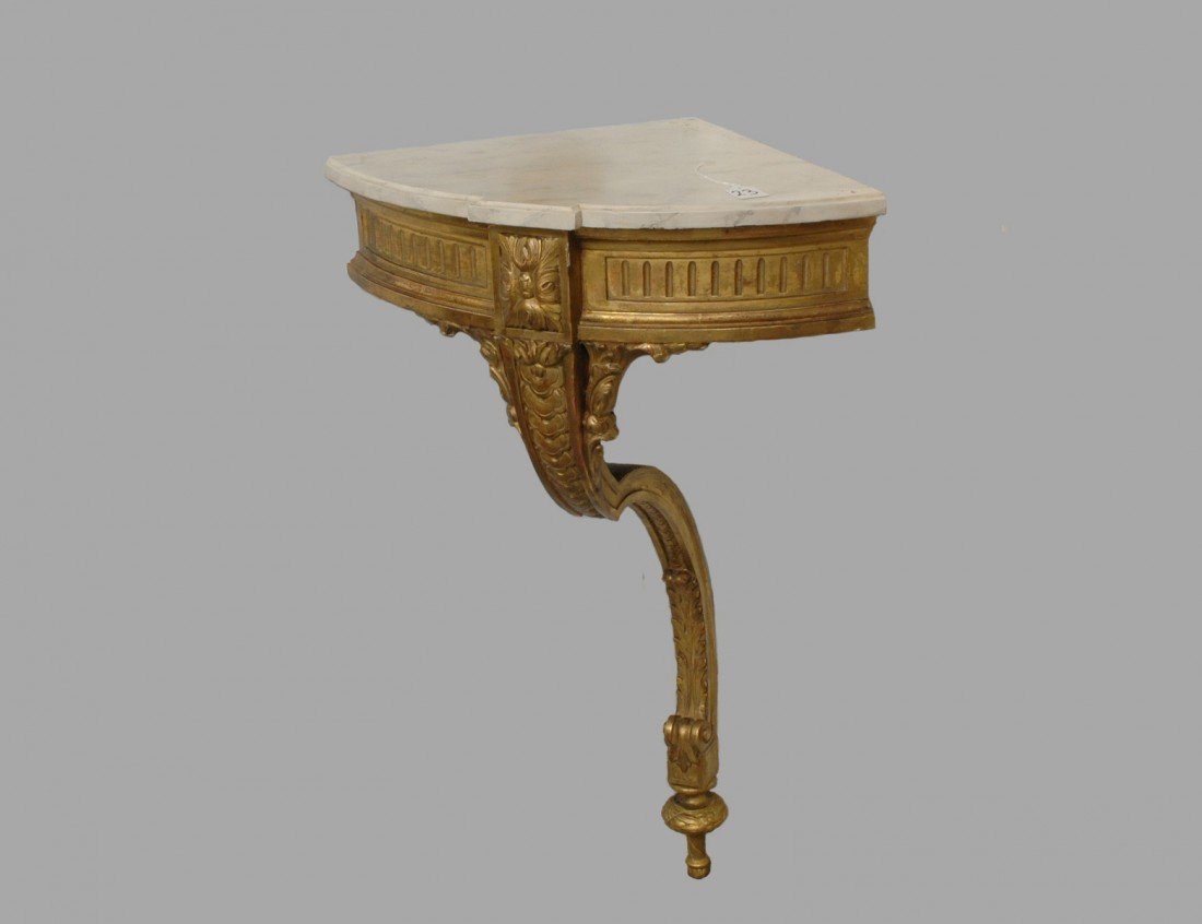 23: NEO-CLASSICAL CARVED AND GILTWOOD CORNER CONSOLE TA