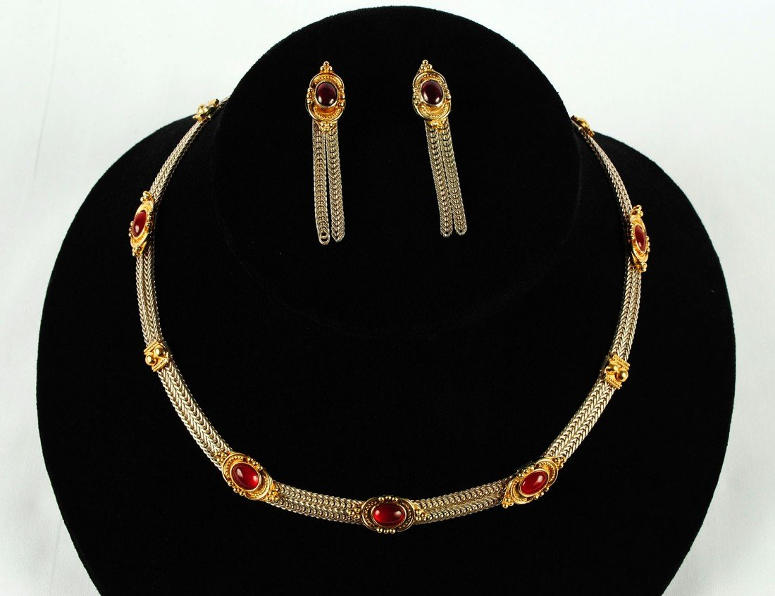18: THREE PIECE STERLING SILVER AND GARNET SUITE OF JEW