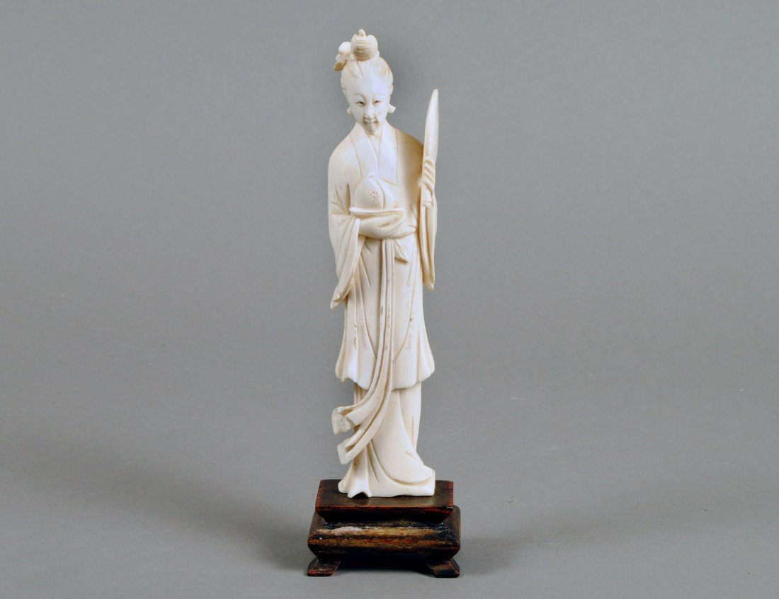11: CARVED IVORY FIGURE OF A FEMALE