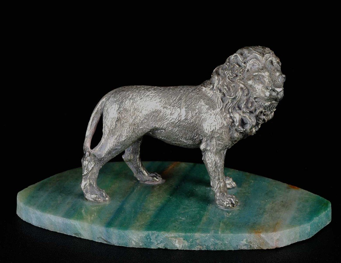 12: SILVER CLAD FIGURE OF A LION