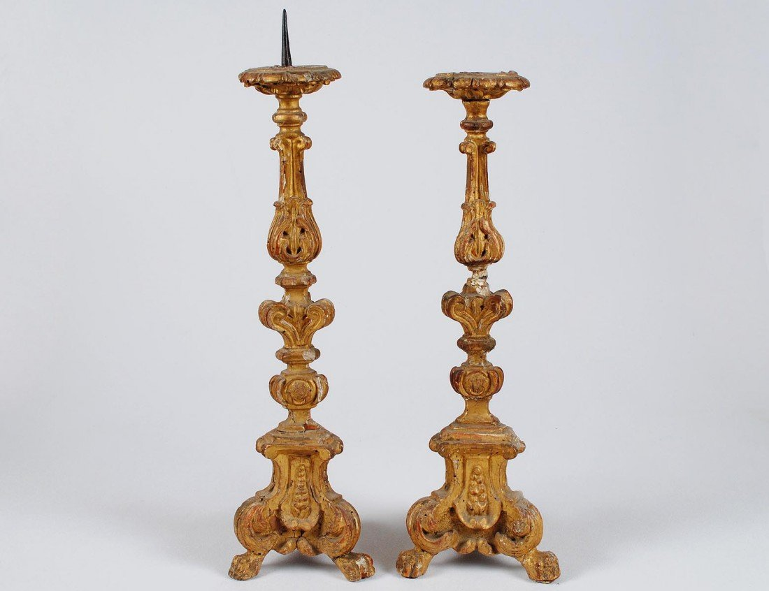 16: PAIR OF BAROQUE STYLE CARVED AND GILTWOOD PRICKET S
