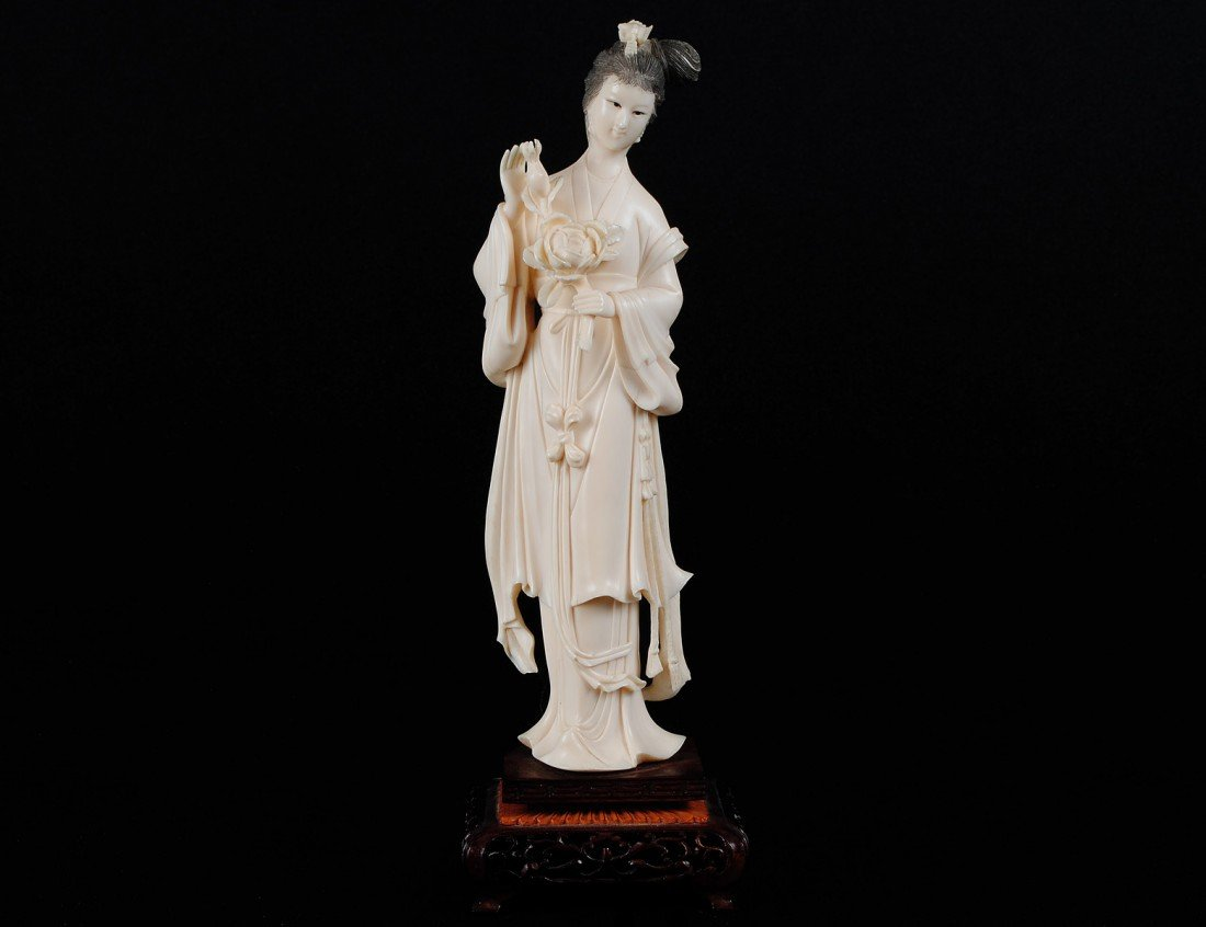 33: CARVED IVORY FIGURE OF A MAIDEN