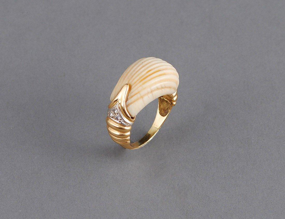 18: EIGHTEEN KARAT GOLD, IVORY AND DIAMOND RING
