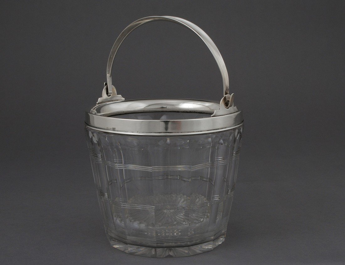 17: STERLING SILVER MOUNTED GLASS ICE BUCKET AND STRAIN
