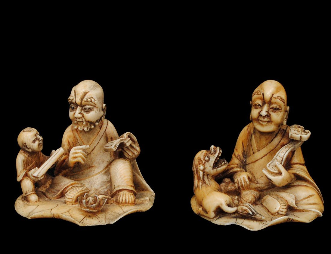28: PAIR OF CARVED IVORY GROUPS