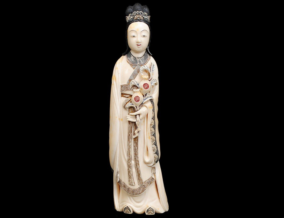 67: CARVED AND POLYCHROMED IVORY FIGURE OF A BEAUTY