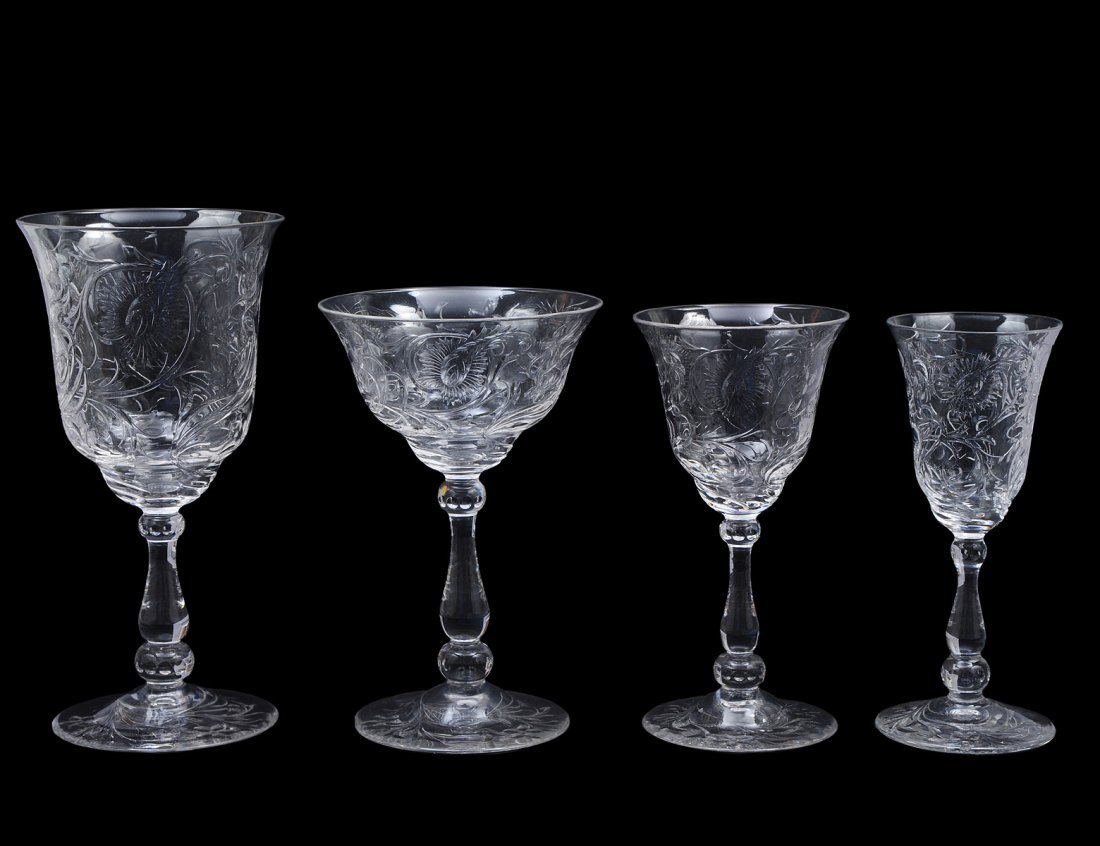 118: FORTY-SEVEN PIECE ENGRAVED GLASS PART STEMWARE SET