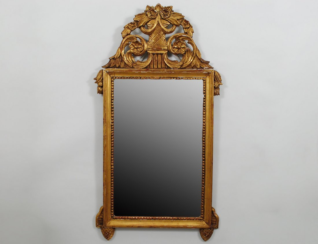 337: CONTINENTAL CARVED GILTWOOD MIRROR