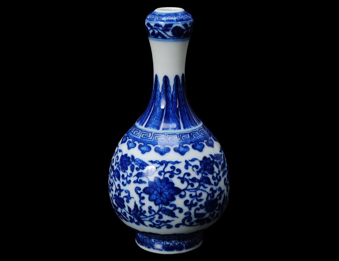 8: BLUE AND WHITE PORCELAIN VASE