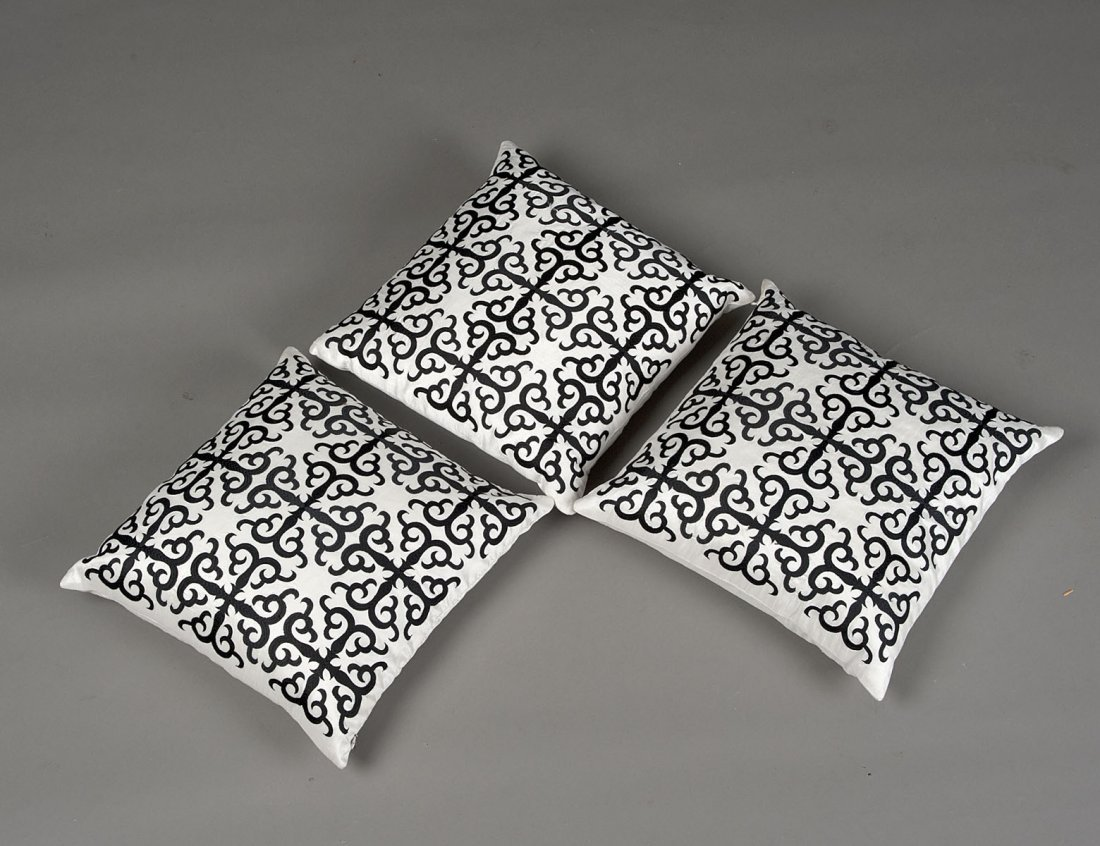 15: GROUP OF THREE BLACK AND WHITE SILK PILLOWS