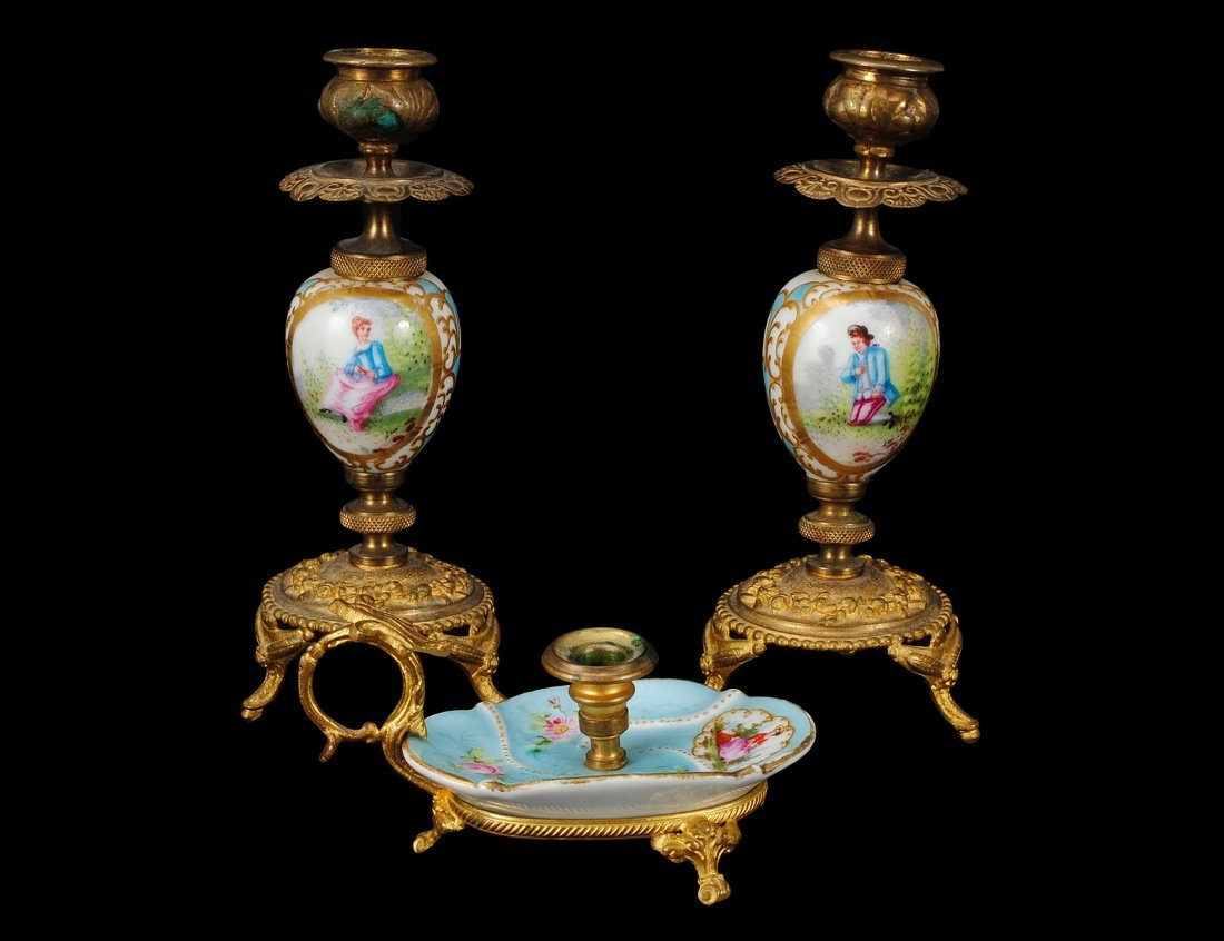 306: PAIR OF PORCELAIN AND BRASS CANDLESTICKS