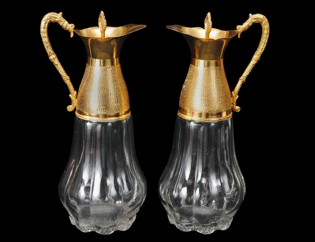 308: PAIR OF GILT METAL MOUNTED GLASS CARAFES