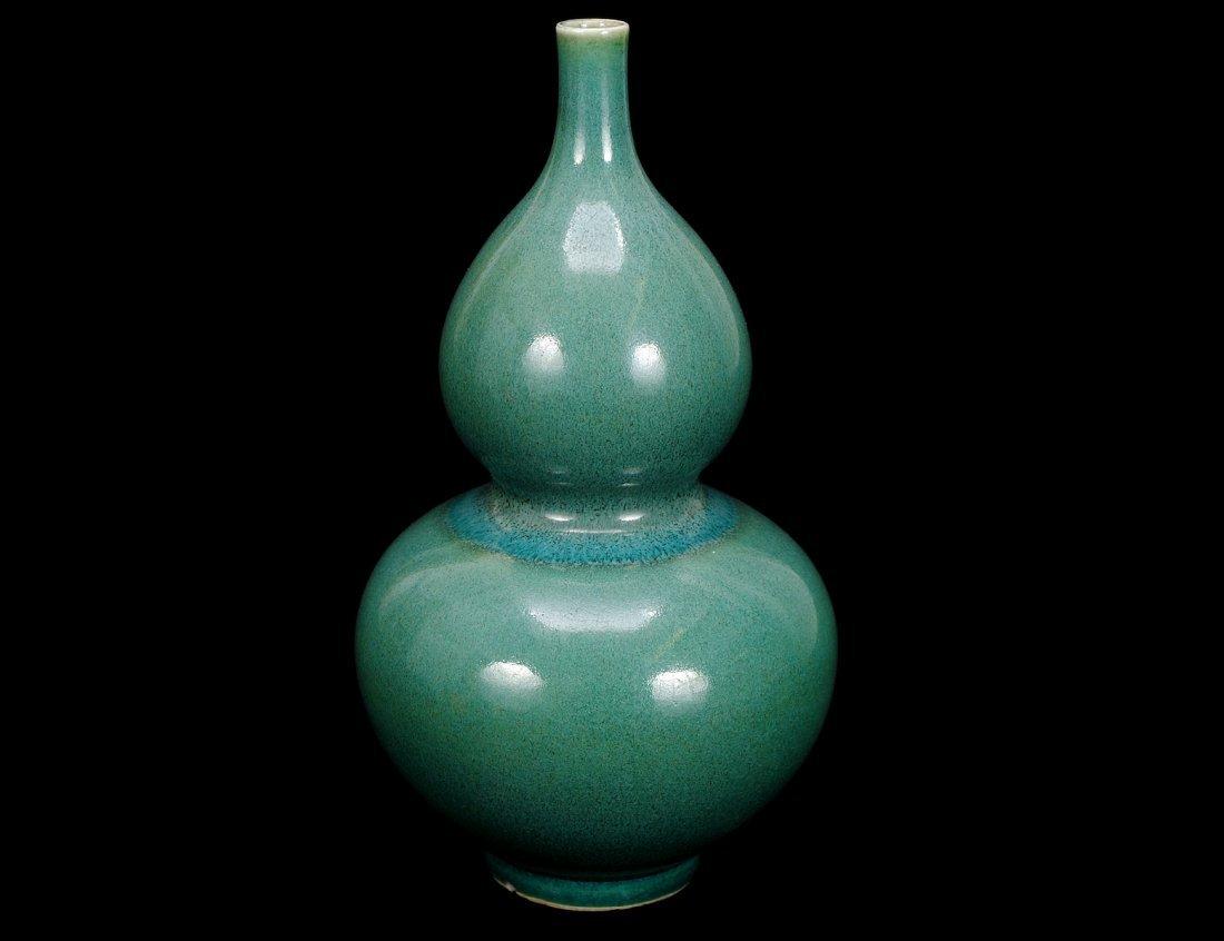 310: GREEN GLAZED PORCELAIN VASE