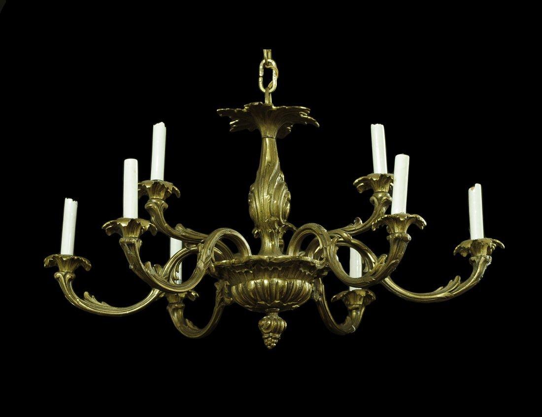 23: LOUIS XVI STYLE NINE LIGHT GILT BRONZE CHANDELIER