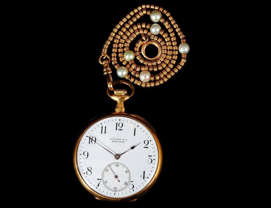 153: TIFFANY & CO. EIGHTEEN KARAT GOLD POCKET WATCH AND
