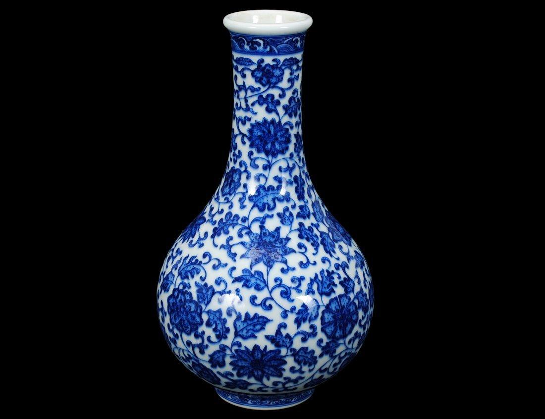 13: BLUE AND WHITE PORCELAIN VASE