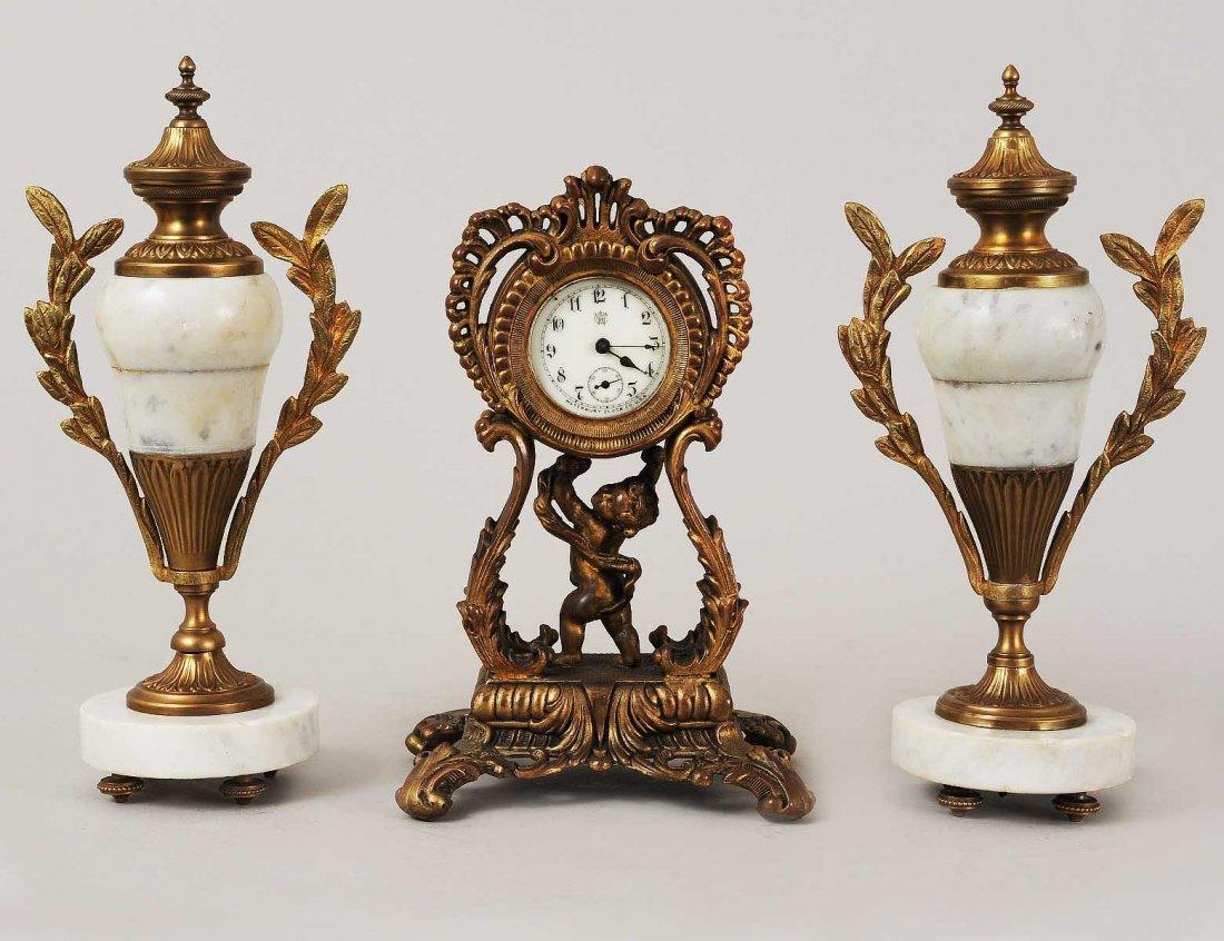 THREE PIECE ASSEMBLED CLOCK GARNITURE