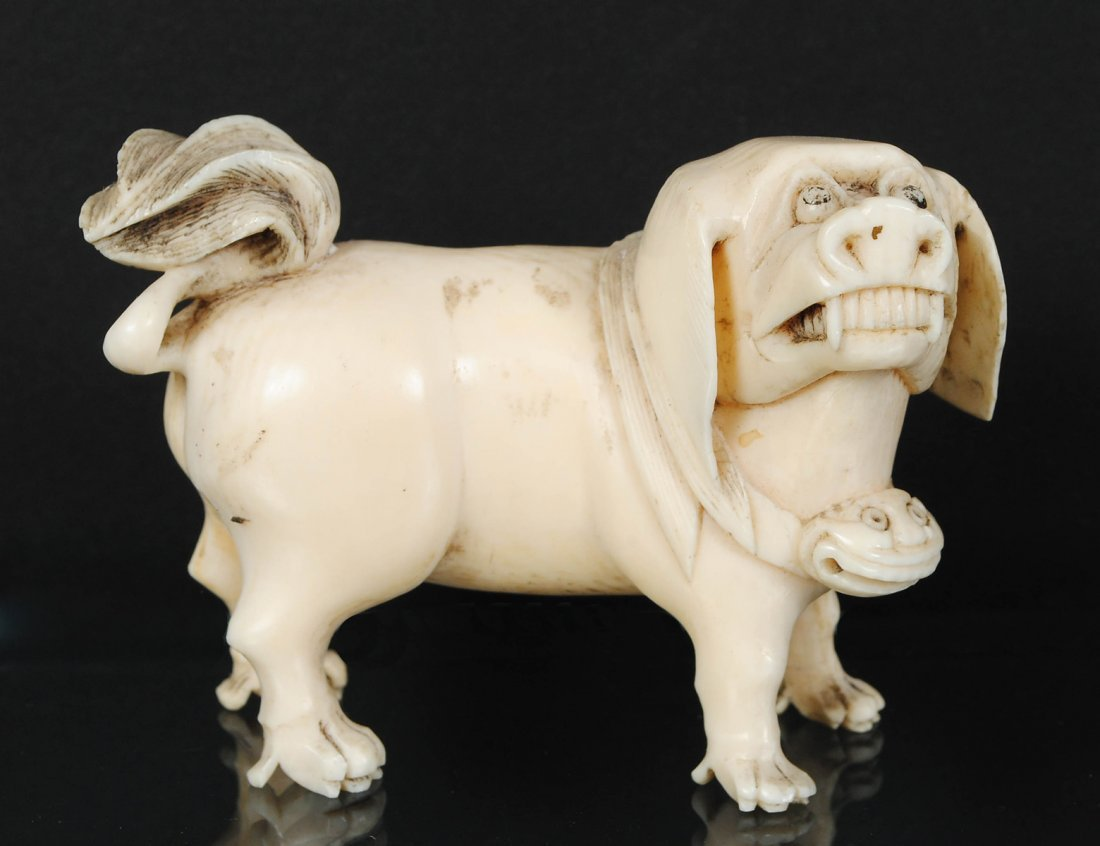 CARVED IVORY STUDY OF A FU DOG