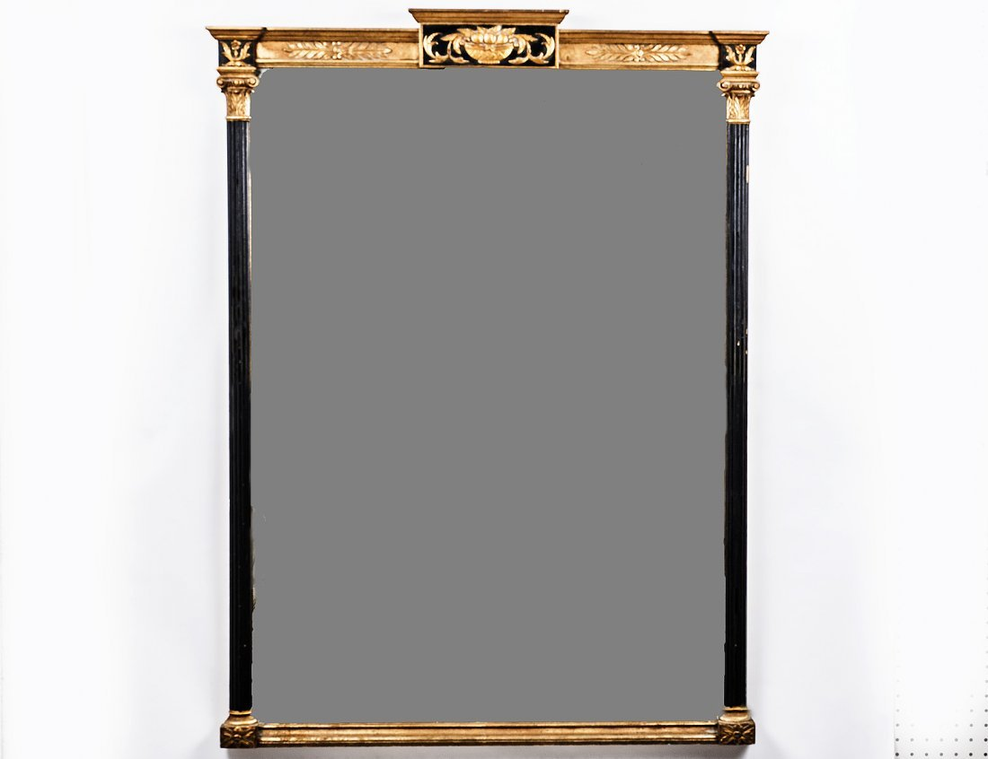 EMPIRE STYLE PARCEL GILT AND EBONIZED MIRROR