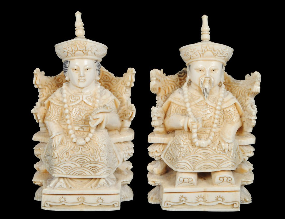 PAIR OF CARVED IVORY EMPEROR AND EMPRESS