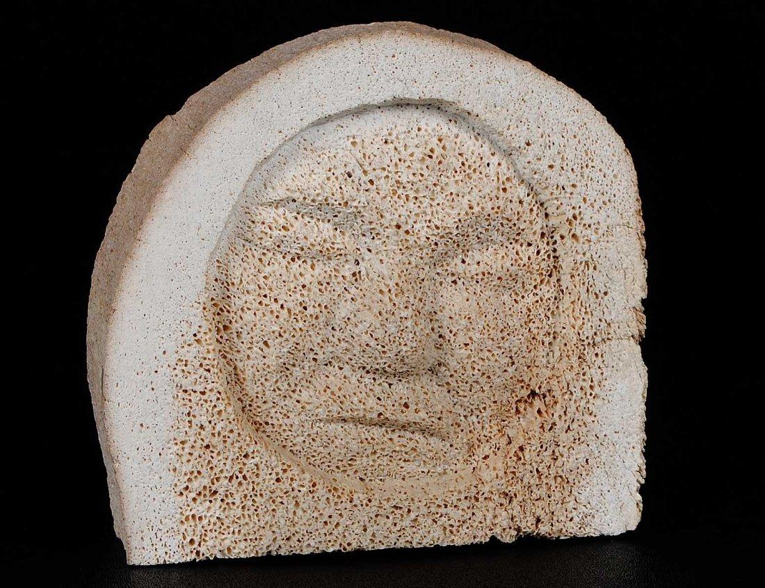 CARVED WHALE BONE OF A HEAD