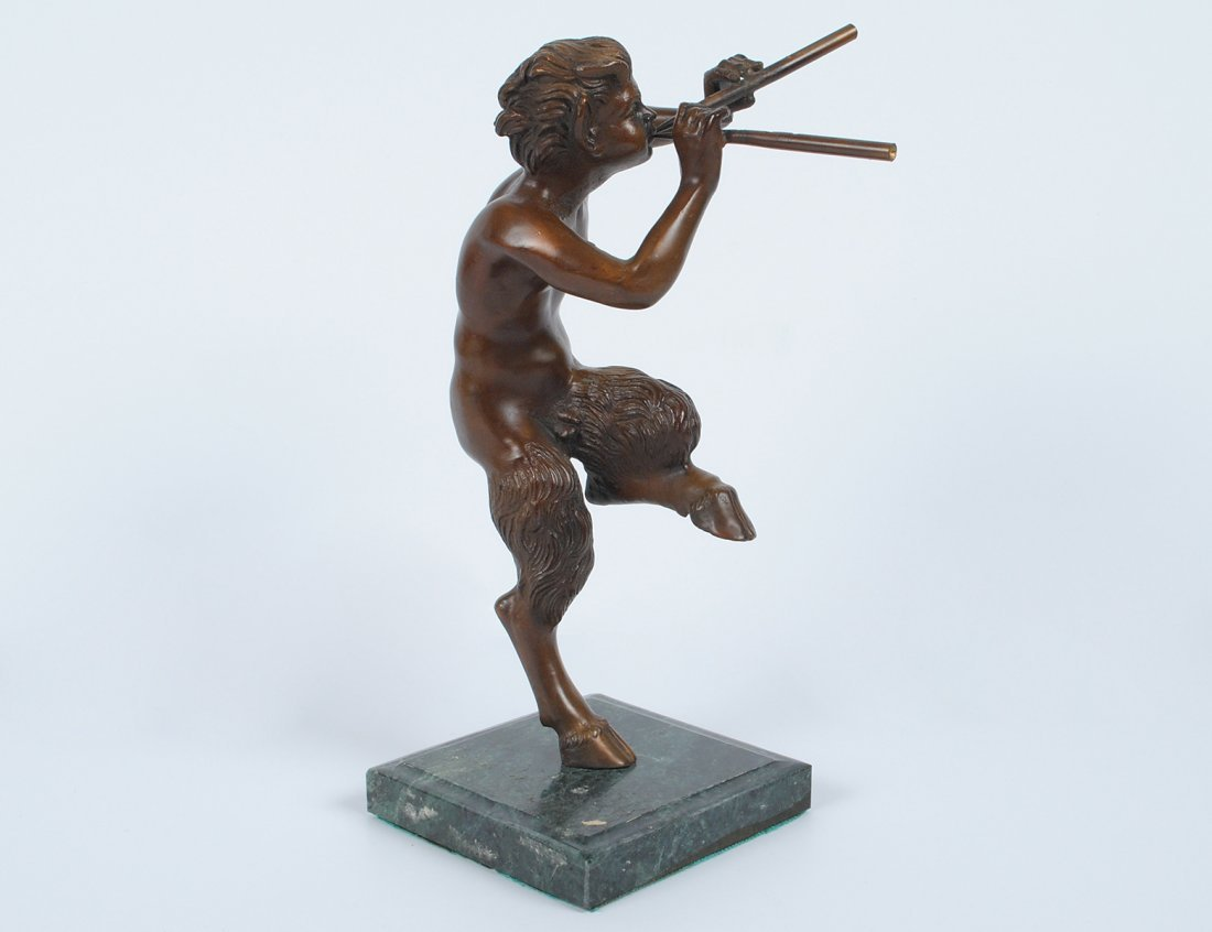 PATINATED BRONZE FIGURE OF A YOUNG SATYR