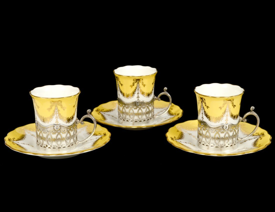 SET OF THREE COALPORT PORCELAIN STERLING SILVER CUPS