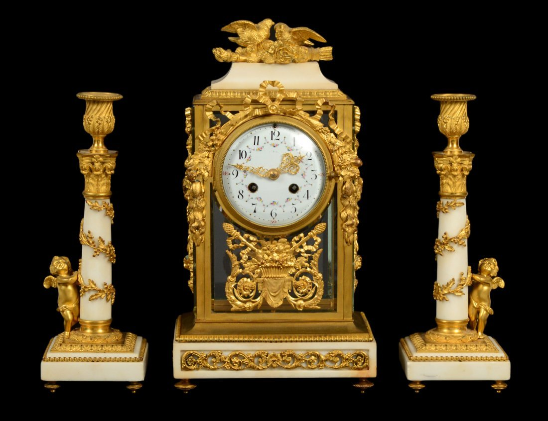 THREE PIECE LOUIS XVI STYLE GILT BRONZE AND MARBLE
