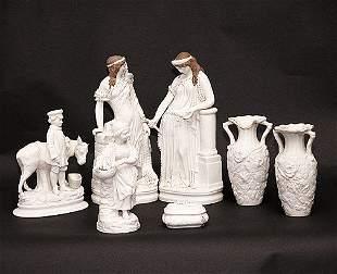 Seven White Bisque Porcelain Figural Gro