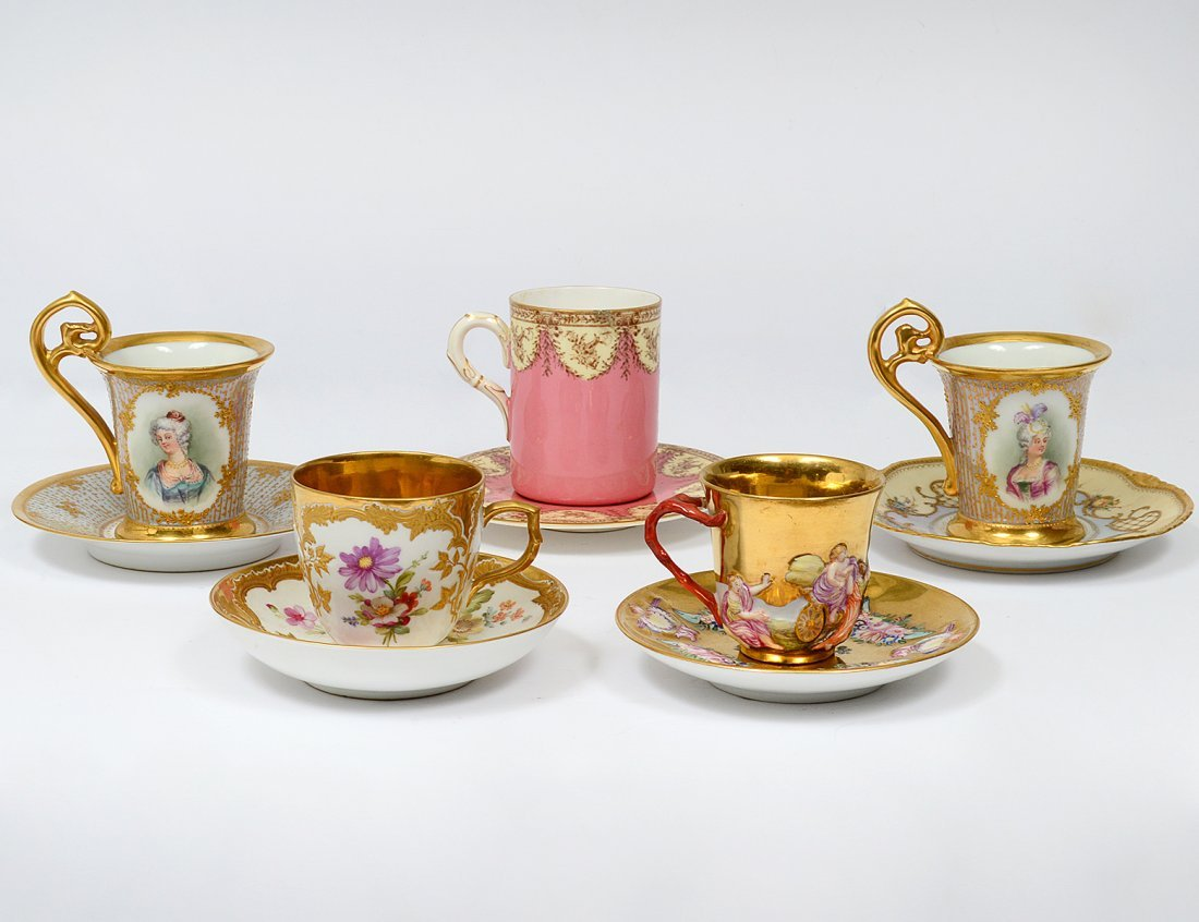 GROUP OF FIVE PORCELAIN DEMITASSE CUPS AND SAUCERS