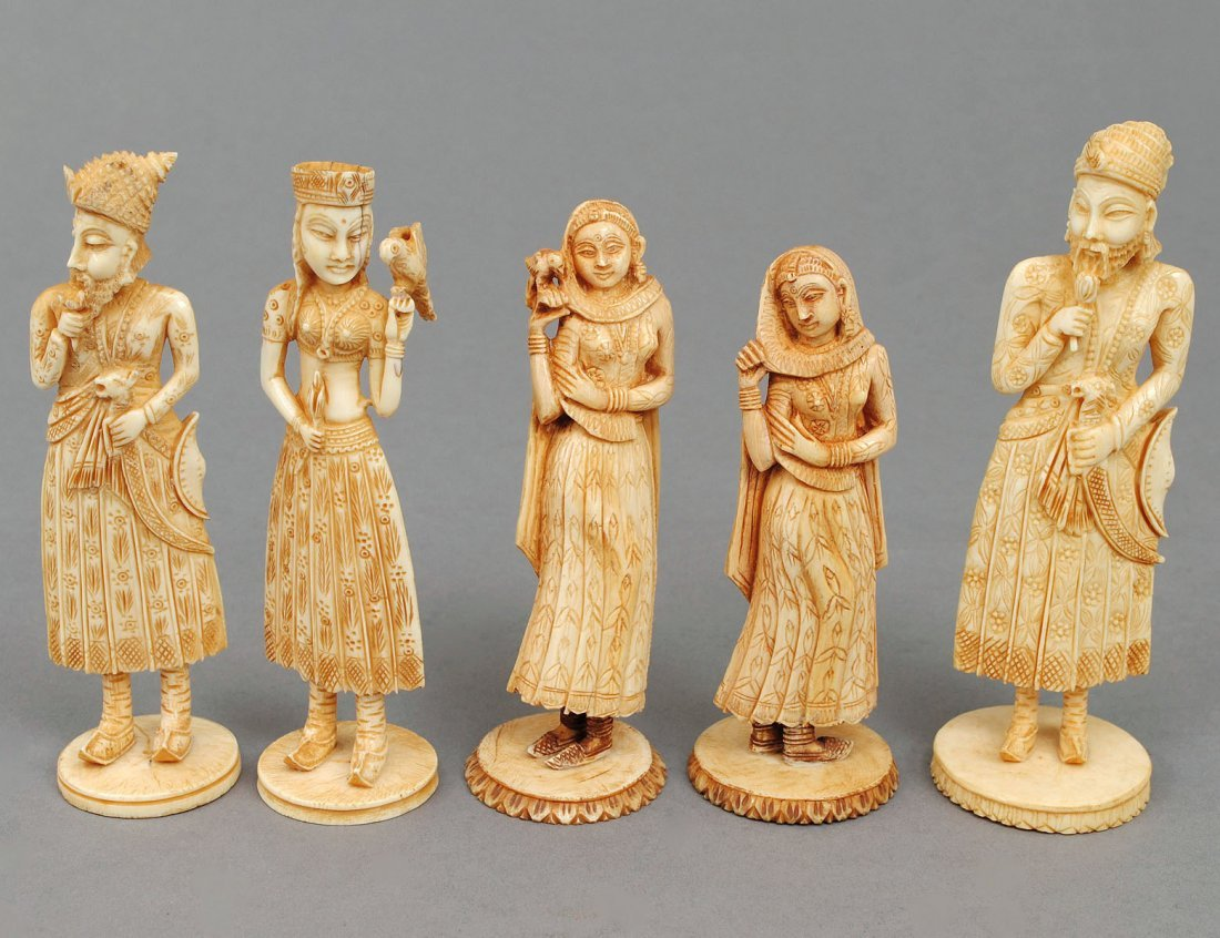 GROUP OF FIVE CARVED IVORY FIGURES