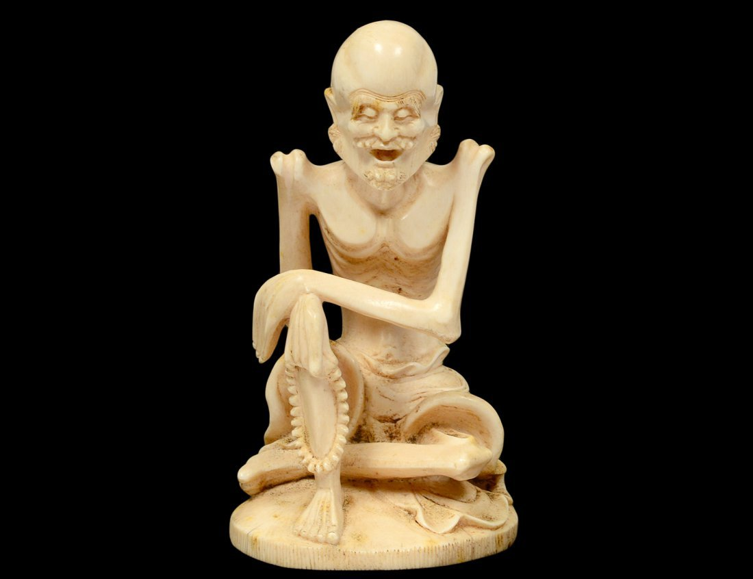 CARVED IVORY FIGURE OF A SKELETON MAN