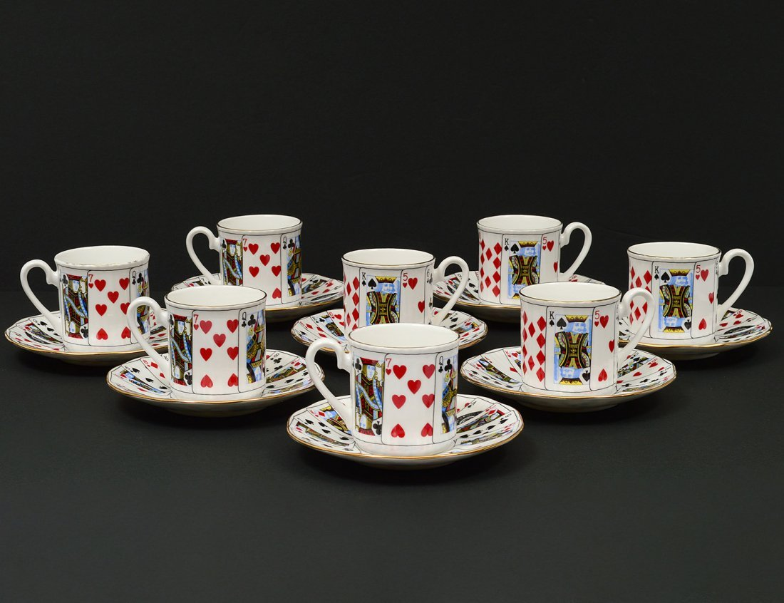 SET OF EIGHT STAFFORDSHIRE PORCELAIN COFFEE CUPS AND