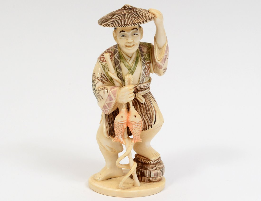 CARVED IVORY FIGURE OF A FISHERMAN