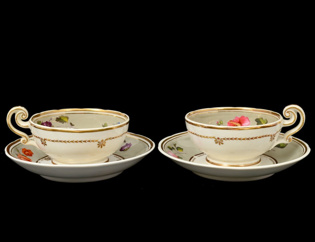 PAIR OF PORCELAIN TEA CUPS AND SAUCERS