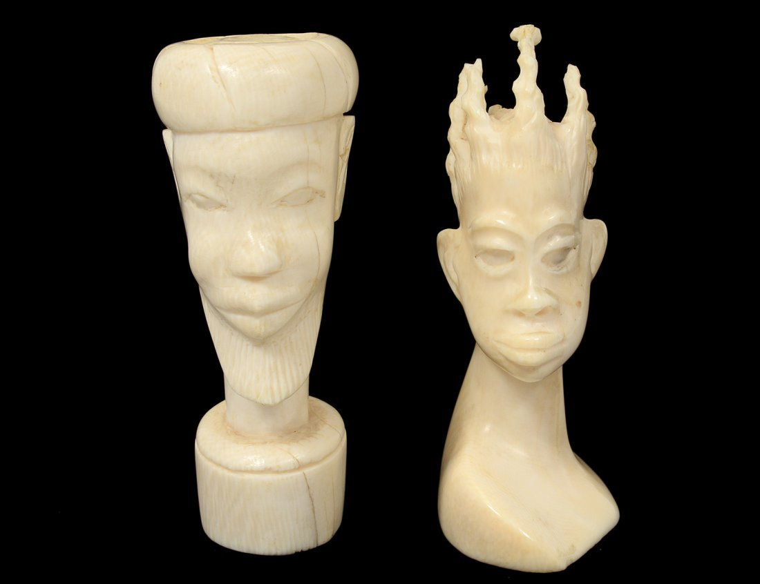 TWO TRIBAL CARVED IVORY HEADS
