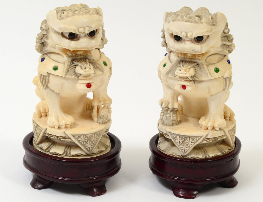 "PAIR OF CARVED ""JEWELED"" IVORY FU DOGS"