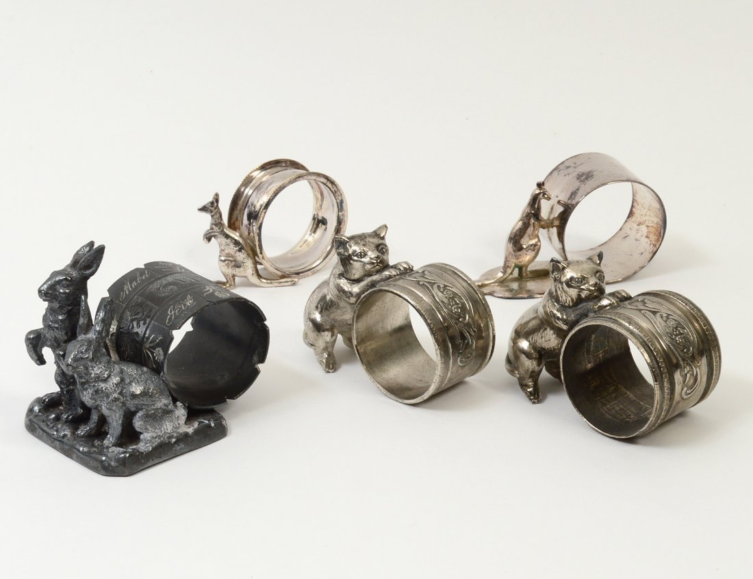GROUP OF FIVE VICTORIAN SILVER PLATED NAPKIN RINGS