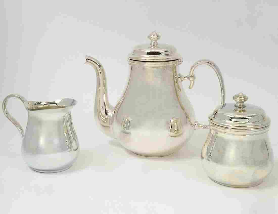 THREE PIECE CHRISTOFLE SILVER PLATED TEA SERVICE