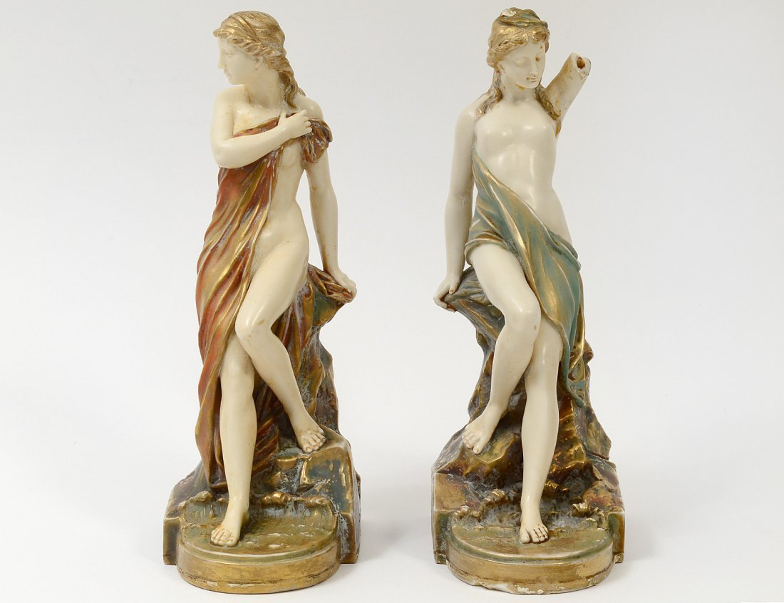 PAIR OF ROYAL WORCESTER PORCELAIN FIGURAL BOOKENDS