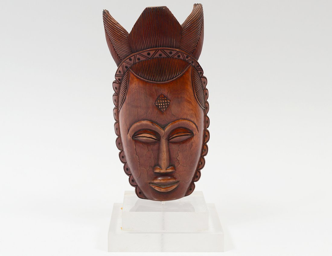 LACQUERED IVORY MASK OF A FEMALE