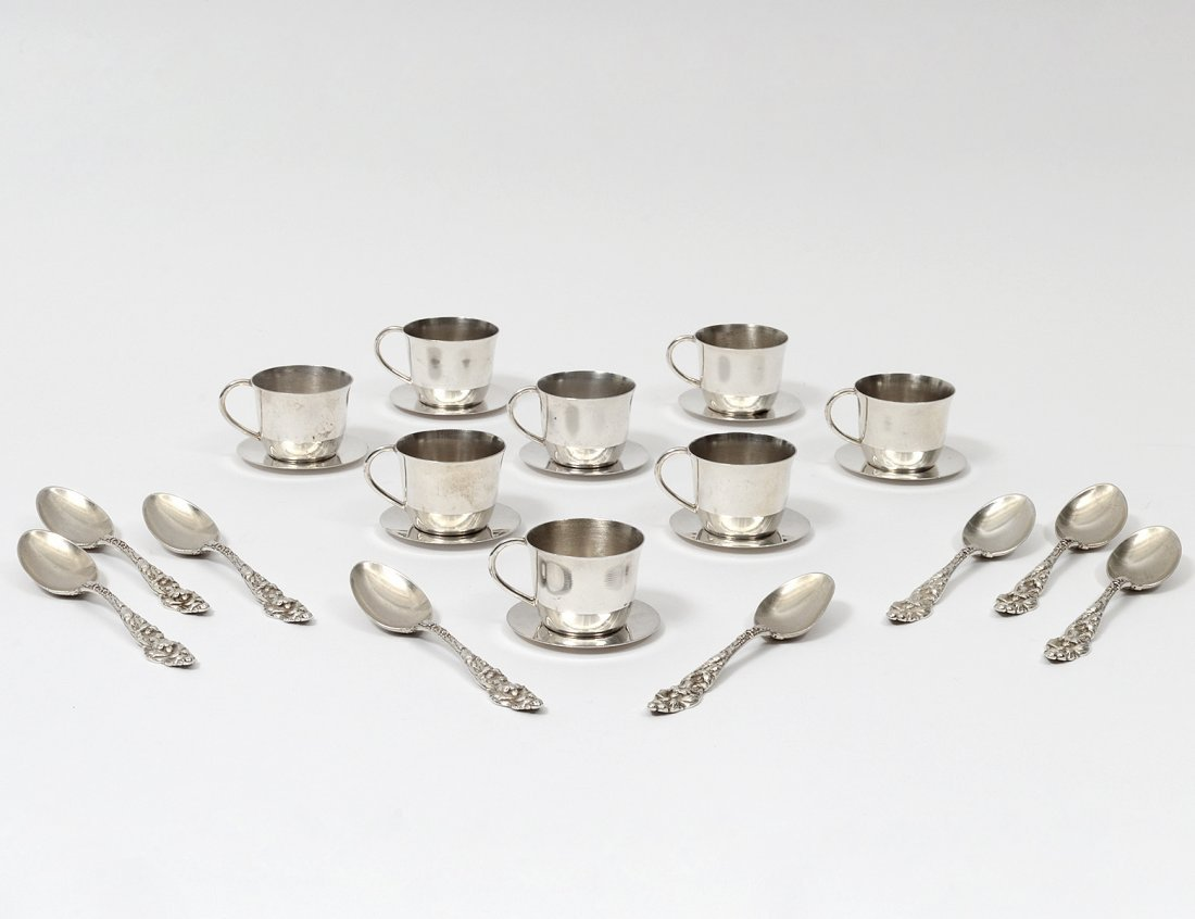 SET OF EIGHT STERLING SILVER MINIATURE CUPS AND SAUCERS