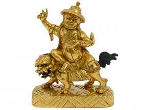Gilt Bronze Group Of A Mounted Buddhist Temple Guardian