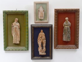 Group Of Four Carved Wood Santos